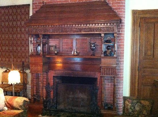 Grand Victorian Bed and Breakfast: Can you believe that this amazing mantel was once covered by 10 layers of paint?