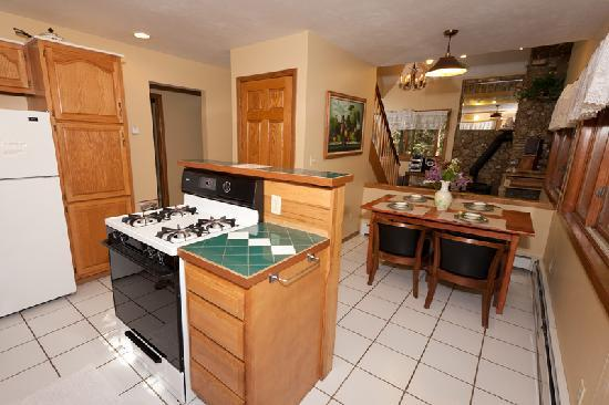 Door County Cottages: Gretnas: Fully equipped kitchen that goes out onto a sunroom and looks through to the sunken liv