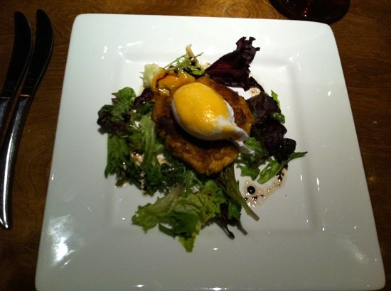 Robert Irvine's eat! : Crab cake with egg and greens.