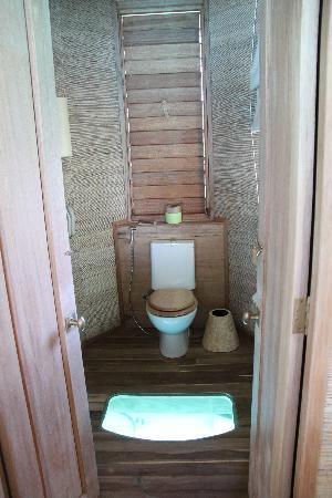 Six Senses Laamu: Toilet with Glass Window on the Floor