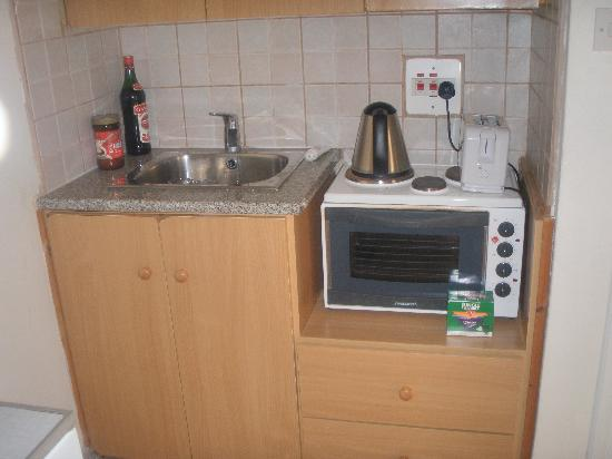 Daphne Hotel Apartments: OUR WELL EQUIPPED KITCHEN (NO WORKSURFACES OR DRAINAGE AREA & 1 SOCKET)