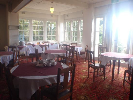 The Cecil Guesthouse: The dining room downstairs. Nice light and view.