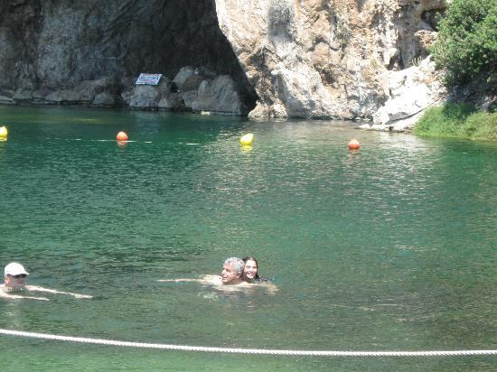 Vouliagmeni Lake: Ioanna swimming with Papou