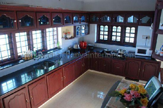 Glory Homestay: Kitchen where your tasty kerala food is prepared, and you can learn some cooking too.