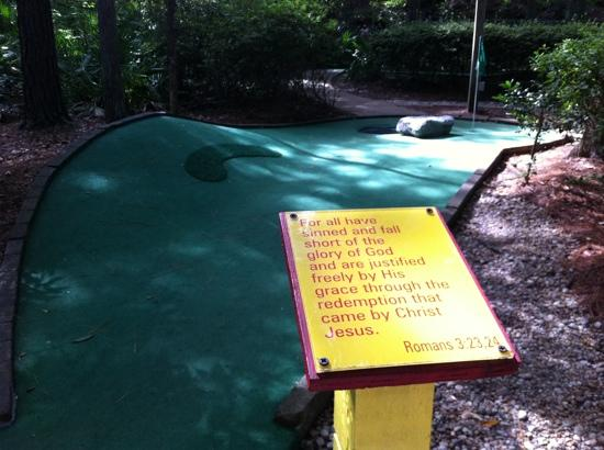 Legendary Golf: Bible verse on card platform.