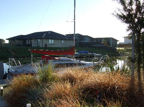 Lake Hood Homestay B&B: Their yacht parked on the canal