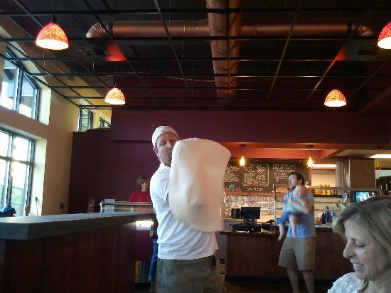 Pisano's Woodfired Pizza : Owner Eddie tossing the dough tableside!