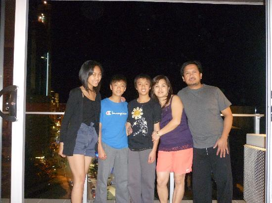 One The Esplanade: Night time family picture from the balcony