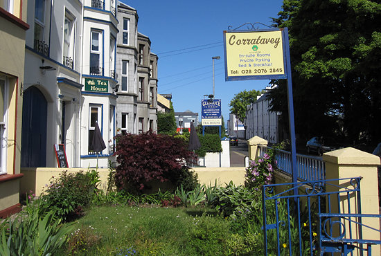 Ballycastle, UK: Blue sign in the background, behind the Corratavey sign