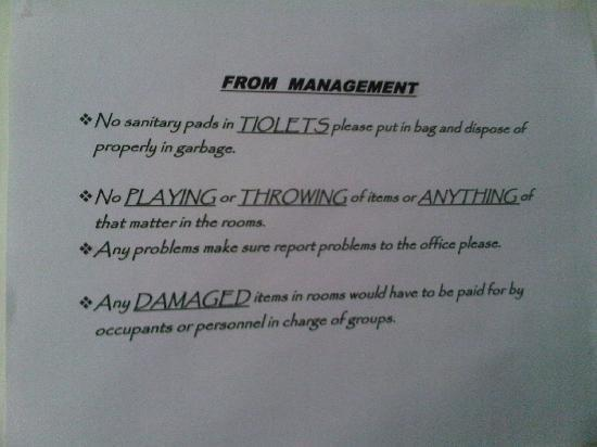 Bay-Hill Apartments: Sign on bathroom door with some grammatical errors