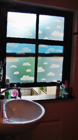Amsterdam Escape: The bathroom window.... Blue sky every morning :)