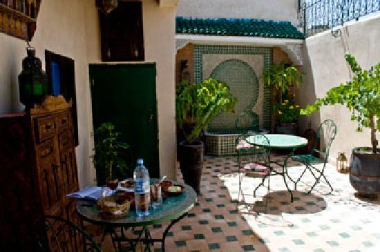 Riad Dar Guennoun: The lower terrace, where I eat the delicious meatball tagine I helped prepare