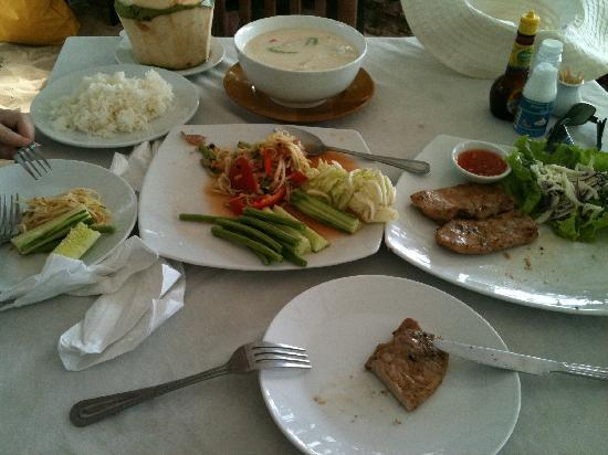 Twin Brothers: fresh coconut, coconut soup, papaya salad and pork chops