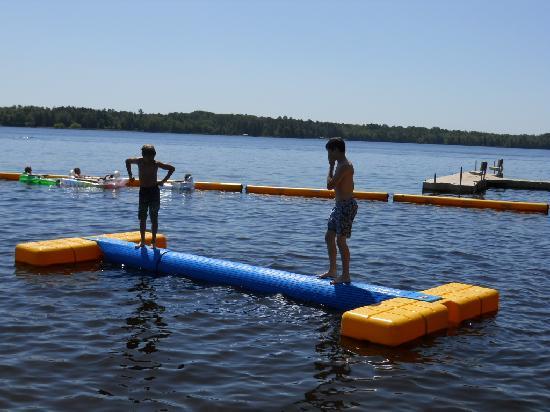 Lake Chippewa Campground : Log rolling at the beach