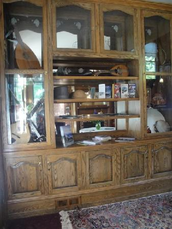 Old Consulate Inn: The foyer and display case of musical instruments.