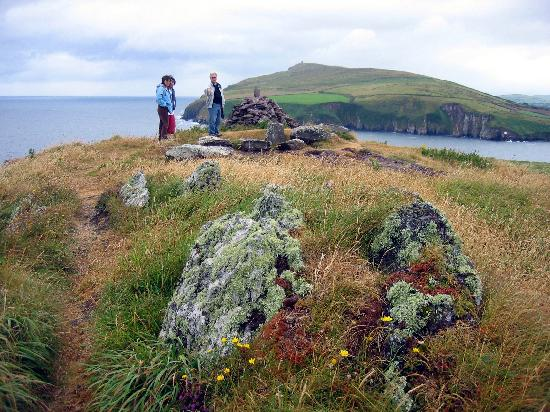 House of Four Angels: Dudley showing us the artifacts. Great Blasket Island in background.