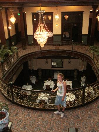 Geiser Grand Hotel: my daughter, overlooking the dining from from the second floor landing under the stained-glass c