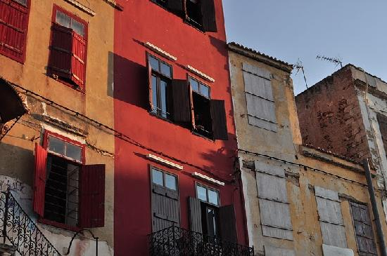 Mama Nena Charming Hotel: the house from the harbor side (the red building)