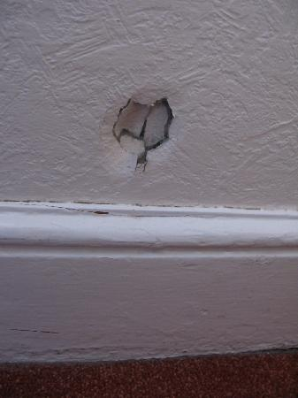 The Esplanade: Hole in the plaster, near the skirting board