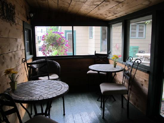 Wooden Boat Inn: common porch area attached to kitchen