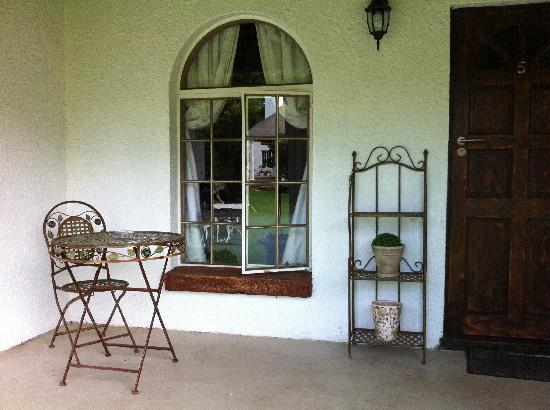 Hadassah's Guest House: The porch to the room - a great place for coffee before work each morning