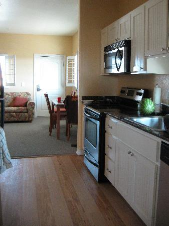 Seashell Village Resort: view of front room and kitchen - we made fish, steak and spaghetti in this great little kitchen!