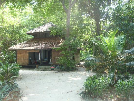 Alam Kotok Island Resort: Our private bungalow, roller blinds all round and our own private beach.