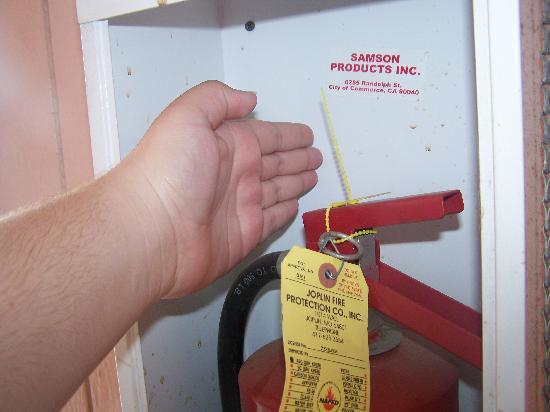 Sunrise Inn: another 2009 extinguisher, broken glass