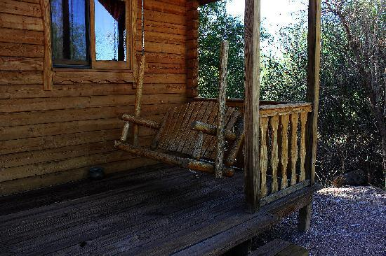 Katie's Cozy Cabins: Porch swing,  it was wonderful having coffee here in the morning