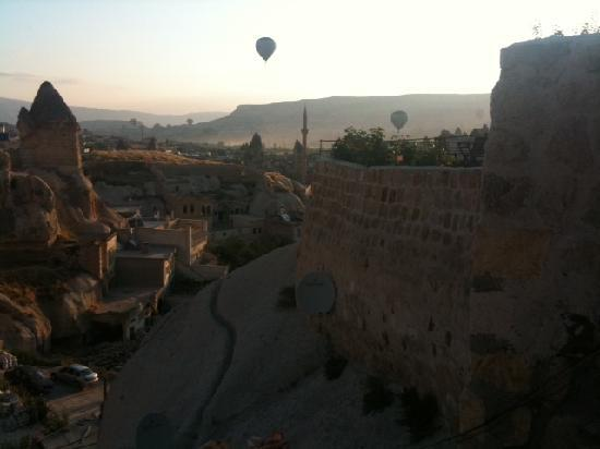 Terra Cave Hotel: If you don't take a hot air balloon ride make sure you get up early one day to watch the watch t
