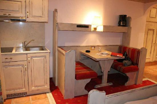 Ferienclub Breitenbergerhof: closer view of kitchenette, dinette, peek of big storage wall in entry hall.