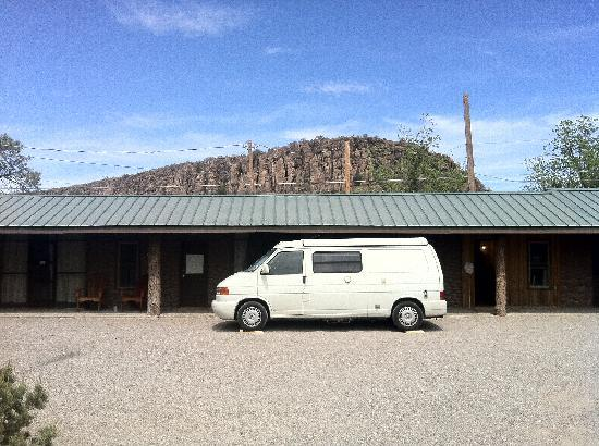 "The Stone Village Tourist Camp: Parked in front of the ""camp room."""