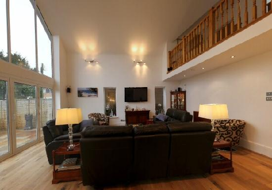Kenton House: Living Room With Huge TV and Nice Sofas