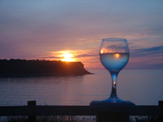 Wine At Sunset Patio Dining At Hometown Kitchen In Cheticamp, Nova Scotia