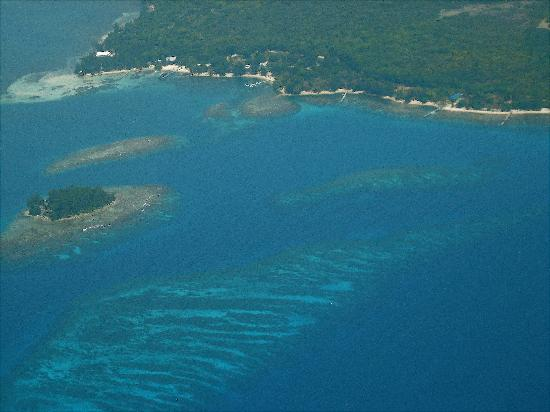 utila' southwest shore with diamond cay in the foreground.
