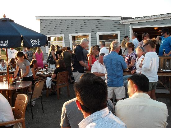 Matunuck Oyster Bar: The scene as we waited. Faces have been obscured, to protect the perhaps not-so-innocent.