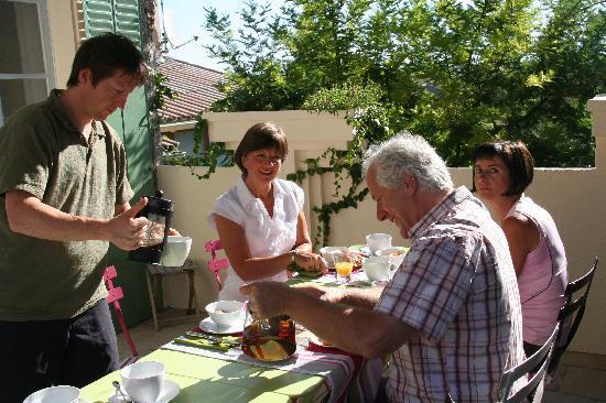 Le Saint Andre : Breakfast on the patio — Darren serving coffee.