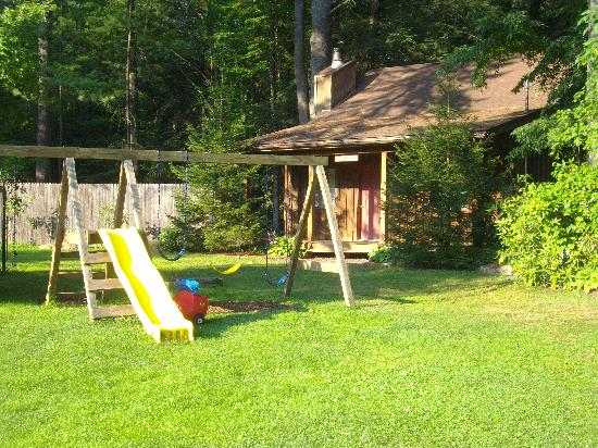 Martinville Streamside Cottages: Playground , Love Shack cottage in the backround