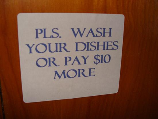 Cozy Court Motel: Sign on cupboard door.