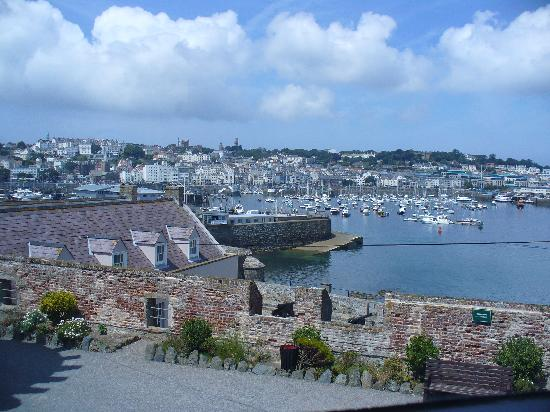 Les Rocquettes: View of St Peter Port harbour & marina from Castle Cornet