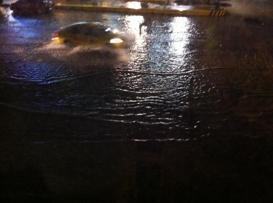 Microtel Inn & Suites by Wyndham Davao: Street in front the hotel during heavy rains.