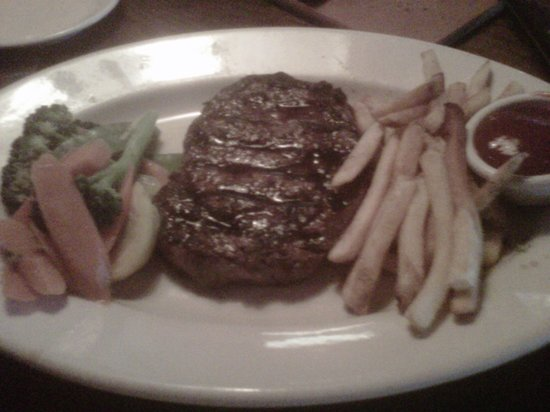 Outback Steakhouse: 14oz Ribeye with fries and seasonal vegetables