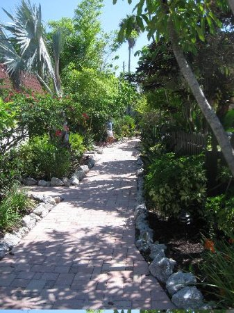 the brick path with lovely landscaping - Picture of Sunrise Garden ...