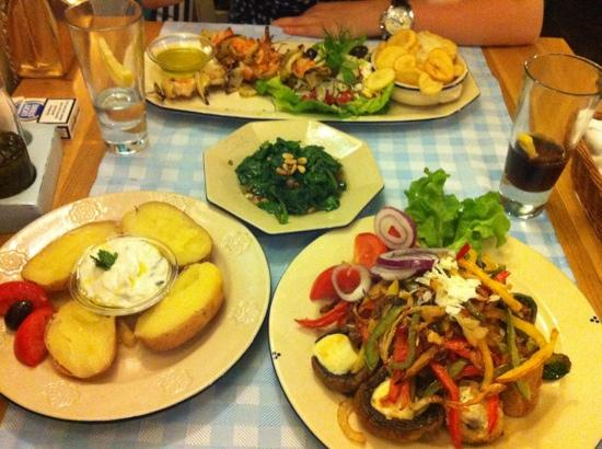 Taverna Dionysos: veggie main course with baked potatoes and grilled shrimp with spinach for my friend