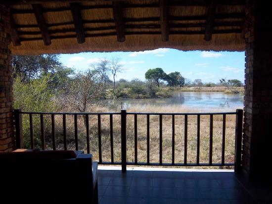 Gomo Gomo Game Lodge: Chalet porch, view of watershed