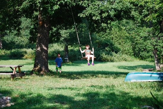 Shady River Getaway: Swinging in the meadow in front of our cottage
