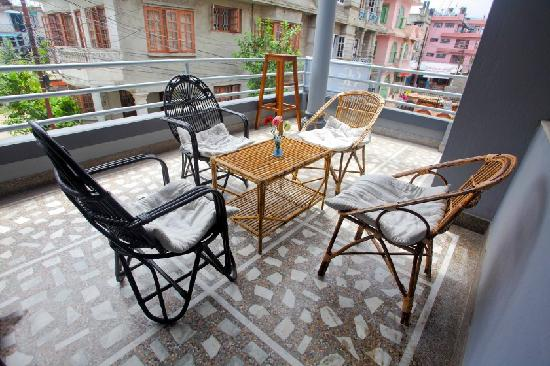 The Hub, Lazimpat: Balcony arranged with cane furnitures to seat and relax