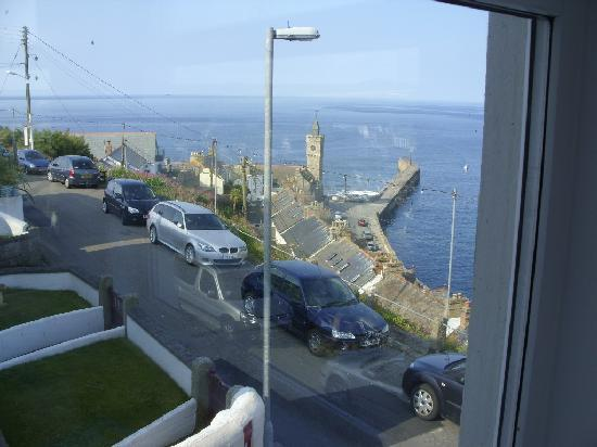 An Mordros Hotel: The breakwater and the Institute clock tower from a bedroom window