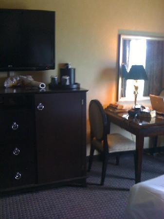 Hollywood Casino Tunica Hotel: TV and Dresser with fridge in side