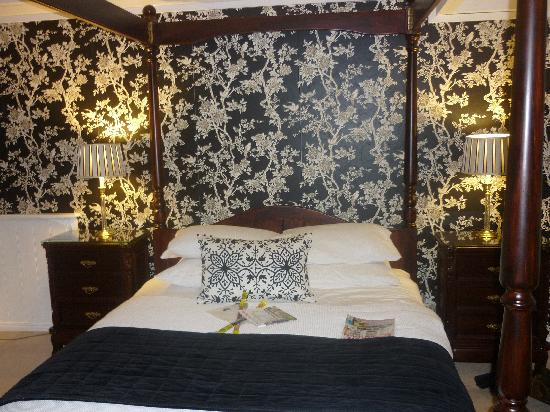 The Loft In The Mill Boutique Accommodation: The four poster bed in the loft apartment